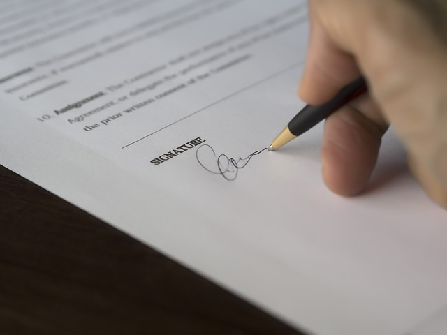 A person signing a paper.